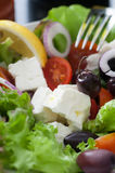 Feta Salad. Green salad feta cheese, black olives, tomatoes, spanish onion. Served with olive oil, pepper and lemon stock photo