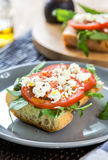 Feta with tomato and rocket sandwich Royalty Free Stock Image