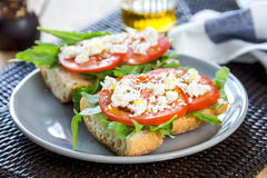 Feta with tomato and rocket sandwich Stock Image