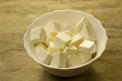 Feta is a traditional Greek cheese on wooden background Royalty Free Stock Images