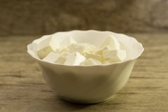 Feta is a traditional Greek cheese on wooden background Stock Photography