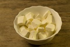 Feta is a traditional Greek cheese on wooden background Royalty Free Stock Image