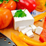 Feta with vegetables and herbs on wooden board Stock Photography