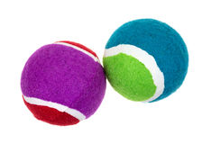Fetch Balls Side View. Two colorful fetch balls for dogs on a white background stock photo