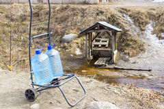 Fetch water at the spring Stock Photos