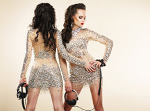 Fete. Clubbing. Two Women in Shiny Silver Dresses with Rhinestones Royalty Free Stock Photo
