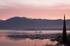 Fethiye Bay sunset. Yachts moored in Fethiye Bay harbor silhouetted at sunset, Mugla, Turkey Stock Image