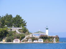 Fethiye Lighthouse. A lighthouse marks the peninsula in Fethiye where boats enter the harbour Royalty Free Stock Photos