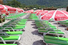 Empty Sunbeds and parasols at Famous Oludeniz Beach Royalty Free Stock Photo