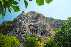 Fethiye rock tombs. 4th BC tombs carved in steep cliff. City of Fethiye, Turkey royalty free stock photography
