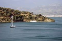 Fethiye sailing boat. Yacht sailing in bay by city of Fethiye, Mugla province, Aegean region, Turkey Stock Images