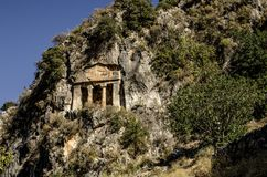 Fethiye, Turkey, Lycian tomb close-up on a rock. Covered with a shrub Stock Images
