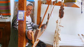 FETHIYE, TURKEY- MAY 2015: turkish woman weaving loom machine stock video footage