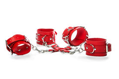 Fetish cuffs for sexual role playing. Fetish Hand cuffs made of red leather for BDSM stock photography