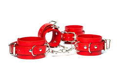 Fetish cuffs for sexual role playing. Fetish Hand cuffs made of red leather for BDSM stock photo