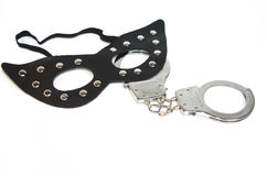 Fetish mask and a handcuff Royalty Free Stock Images