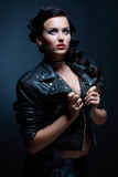 Fetish model in sexy outfit. In leather rock jacket. Blue tone Royalty Free Stock Image