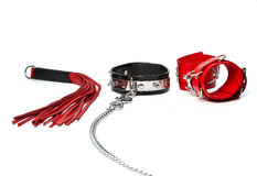 Fetish stuff: hand cuffs, flogger and collar with chain Stock Image