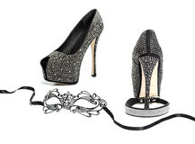 Fetish stuff: high heels, mask and collar. Various fetish stuff for role playing and BDSM: mask, leather collar and shiny high heels shoes with rhinestones royalty free stock photos