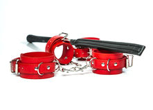Fetish stuff:  leather flogger or whip and hand cuffs Stock Photo