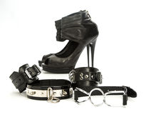 Fetish stuff and sex toys for BDSM. Various fetish stuff for role playing and BDSM: hand cuffs, a gag and high heels shoes Royalty Free Stock Photography