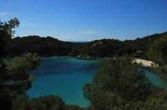 Fetovaia beach, Elba island. Fetovaia bay in the south of island of Elba with Corsica island on the horizon with its mountains. Tyrrhenian sea, Tuscan Royalty Free Stock Photos