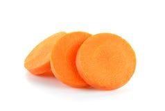 Fetta con la carota isolata sui precedenti bianchi Immagini Stock Libere da Diritti