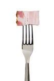 Fetta del bacon sulla forcella Fotografie Stock Libere da Diritti