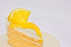 Fetta del dolce ed inceppamento arancio lustrato Immagini Stock