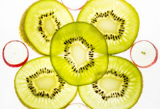 Fetta del kiwi su un fondo leggero Fotografia Stock