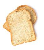 Fetta del pane del pane tostato isolato su fondo bianco Fotografia Stock