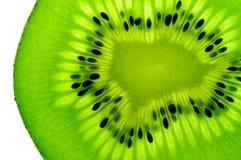 Fetta della frutta di Kiwi (posteriore illuminato) Fotografie Stock Libere da Diritti