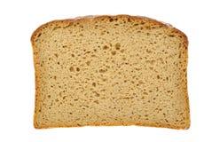 Fetta di pane marrone con i percorsi di residuo della potatura meccanica fotografia stock