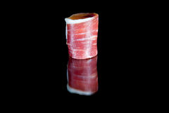Fetta di prosciutto curato di iberico Immagine Stock