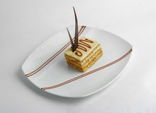 Fetta di torta della vaniglia Fotografia Stock