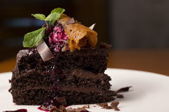 Fetta di torta di cioccolato Immagini Stock