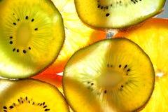 Fette arancio e kiwi Fotografie Stock Libere da Diritti