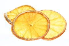 Fette arancio secche della frutta isolate su fondo bianco organico Fotografie Stock