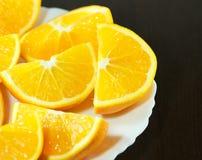 Fette arancio su un piatto Immagine Stock Libera da Diritti