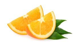Fette arancioni isolate su bianco Fotografia Stock