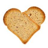 Fette biscottate in forma di cuore del pane Fotografia Stock