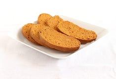 Fette biscottate su un piatto Fotografia Stock Libera da Diritti