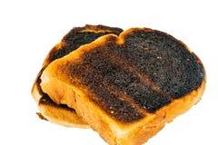 Fette bruciate del pane del pane tostato Fotografie Stock Libere da Diritti