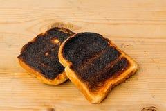 Fette bruciate del pane del pane tostato Fotografia Stock
