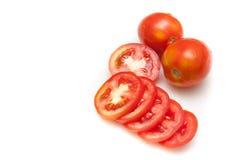 Fette dei pomodori su fondo bianco isolato Fotografia Stock