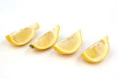Fette del limone su bianco Immagine Stock Libera da Diritti