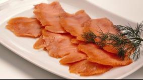 Fette del salmone affumicato stock footage