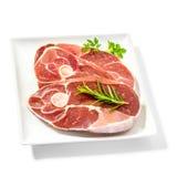 Fette dell'agnello sul piatto con le erbe della spezia Fotografia Stock Libera da Diritti