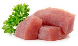 Fette della carne fresca isolate sui precedenti bianchi Immagine Stock