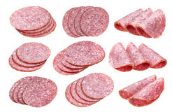 Fette della salsiccia del salame isolate su bianco, con il percorso di ritaglio, raccolta Fotografia Stock Libera da Diritti